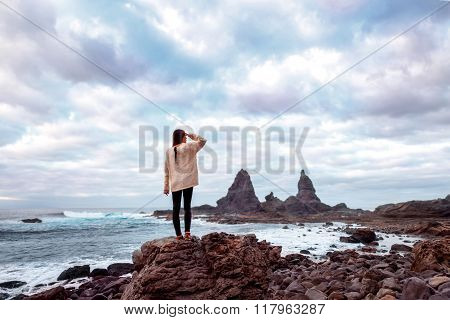 Woman on the rocky coast