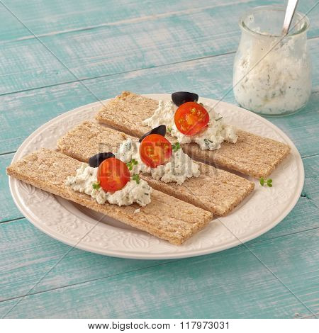 Dry Diet Crisp Breads With Cheese, Cherry Tomatoes And Olives
