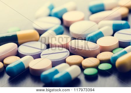 Pharmacy background on a black table. Tablets on a black background. Pills. Medicine and healthy. Cl