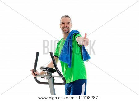 Man With Thumb Up Train With Fitness Machine