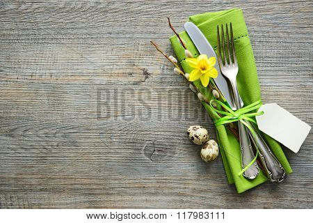 Easter table setting with daffodil and cutlery. Holidays background