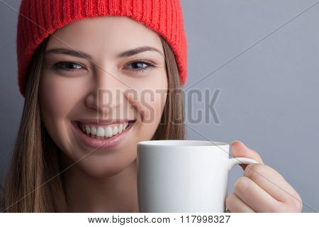 Cute healthy girl is drinking tasty coffee