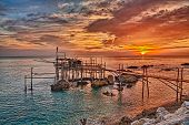 Adriatic sea coast at sunrise in Chieti, Abruzzo, Italy, with an ancient fishing hut trabocco, the typical mediterranean wooden pilework poster