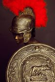 Studio shot of mannequin in armor and in helmet with feathers on head poster