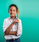 10 year old indian boy playing flute, indian boy and music, indian boy learning music, indian boy with musical instrument, brown indian boy poster
