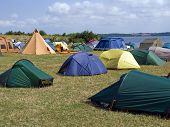 City of colorful tents in a sea beach camping site village poster