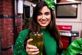 Disguised woman holding a green pint for St Patricks day poster