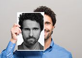 Conceptual image of a man changing his mood poster