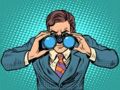 Businessman looking through binoculars. Lead vision Navigator pop art retro style. Business concept vision of the future poster