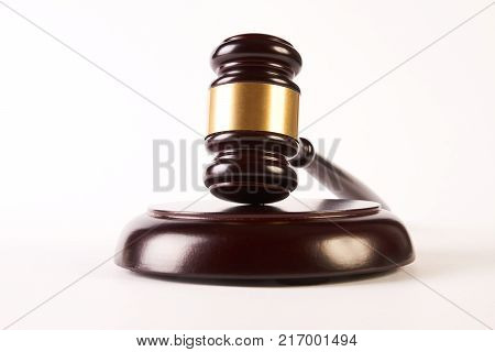 Judges gavel or law mallet and sound block isolated on white background, close-up. Judgement or auction and conceptual of justice and judgements