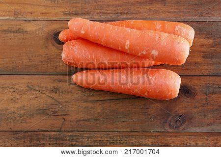 Stack of Carrots on a Wooden Background
