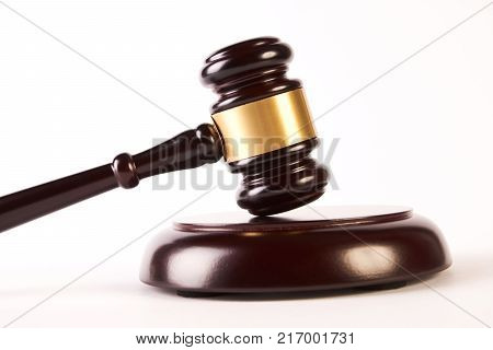 Wooden judge gavel or law hammer and soundboard isolated on white background, close-up. Judgement or auction and conceptual of justice and judgements