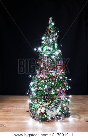 Mini Christmas Tree on Black and Wooden Background