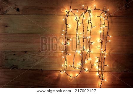 String of Fairy Lights on Wooden Background