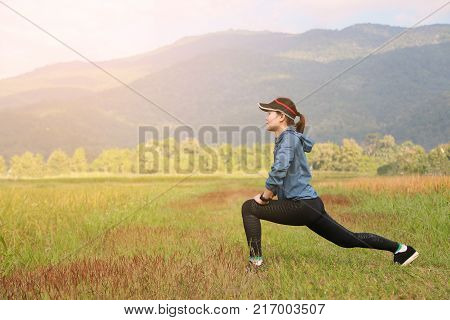 woman is running in the garden or outdoor, Warm up and exercise the body before sport activity, Healthy lifestyle of the people which popular sport is running, People running and jogging for health.