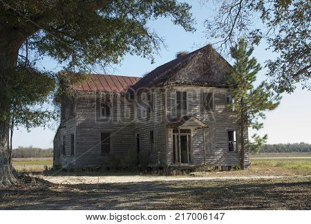 An old farmhouse stands in a state of decay in Craven CountyNorth Carolina