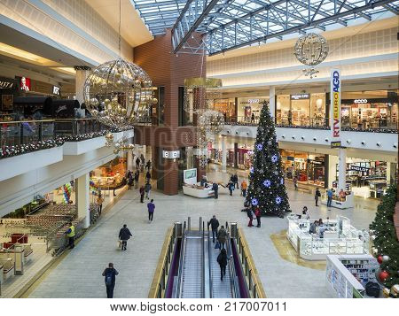 KRAKOW, POLAND - DECEMBER 1, 2017: Christmas decoration, Christmas tree and people shopping in multilevel modern hypermarket Bonarka in Cracow Poland.
