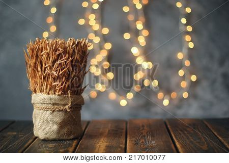 Ears of wheat on old wooden table. Christmas concept