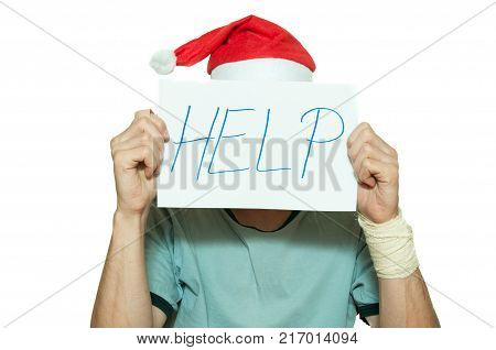 Young man with Santa Claus hat cover his face with help sign after suicidal attempt feeling lonely and sad for New Year and Christmas holidays depression concept isolated on white background
