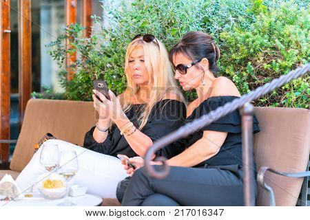 Capri Italy - October 3 2017: Women relaxing at the restaurant on Capri Island Italy