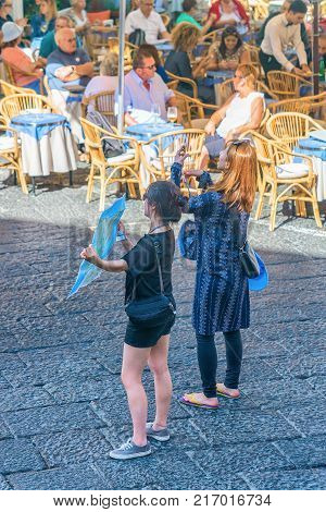 Capri Italy - October 3 2017: Asian tourists with city map on Capri Island Italy