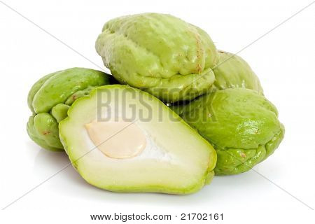 Whole and sliced fresh Chayote, isolated on white background.