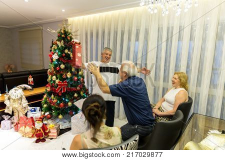 Family on the living room exchanging christmas present