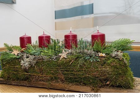 creatively designed Advent wreath in oblong shape - close-up