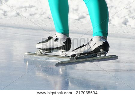 a shot of a speed skating on ice