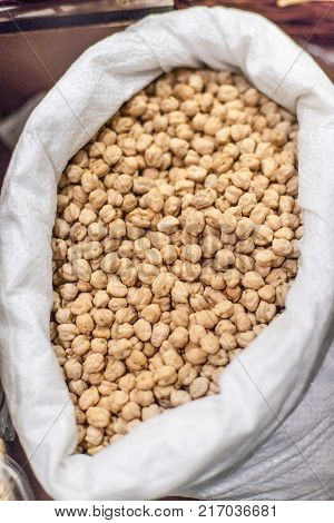 Soy beans in sack on a local farmer market. Healthy local food market concept.