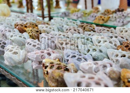 variety of decorative toads made from onyx in a store