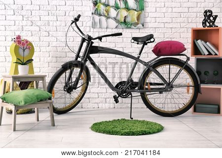 Child's room interior with bicycle and shelving unit