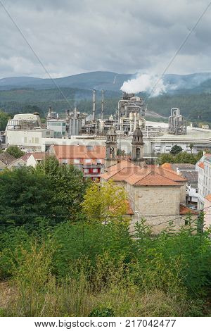 PONTECESURES, SPAIN - SEPTEMBER 10, 2017: Cityscape of Pontecesures with old church and large factory on the Camino de Santiago trail on September 10, 2017, in Galicia, Spain