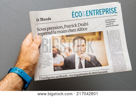 PARIS FRANCE - NOV 19 2017: Man pov at the Patrick Drahi CEO of Altice and SFR in the economical review press of Le Monde newspaper
