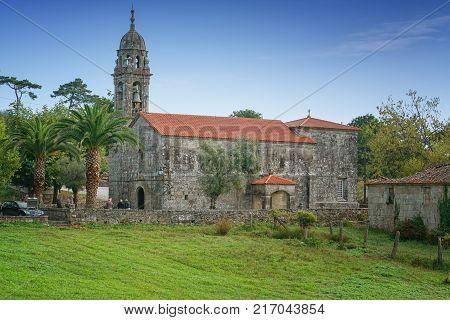 CALDAS DE REIS, SPAIN - SEPTEMBER 10, 2017: Iglesia de Santa Marina de Carracedo in O Cruceiro, a small village on the Camino de Santiago trail close to Caldas de Reis on September 10, 2017 in Galicia, Spain