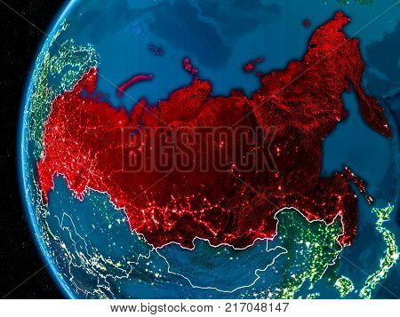Space orbit view of Russia highlighted in red on planet Earth at night with visible country borders and city lights. 3D illustration. Elements of this image furnished by NASA.