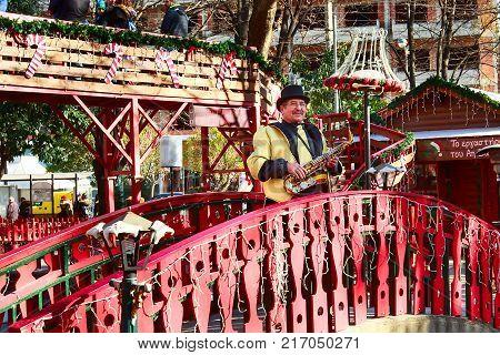 Greece, Drama - December 14, 2016: Man playing saxophone at greek Christmas market in Drama, Greece