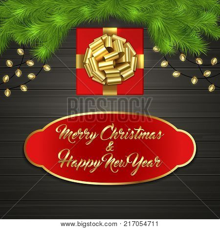 red square gift box with gold ribbon bow garland on black wooden board greeting text merry christmas and happy new year on red label with