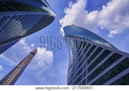 MOSCOW, AUG, 22,2017: View on Moscow City business center skyscrapers office buildings towers luxury apartments. Skyscrapers reflection blue cloudy sky Moscow city buildings wide angle panorama Modern european architecture