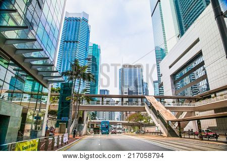 HONG KONG - APR 3, 2016:  Street scene typically Asian with high buildings along both sides and plethora neon signs in Hong Kong on Apr 3, 2016, Hong Kong.