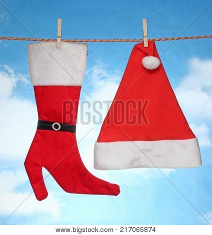 happy Merry X mas Hanging christmas decoration hat and santa socks.