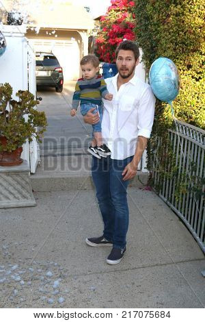 LOS ANGELES - NOV 26:  Scott Clifton, Ford Robert Clifton at the Amelie Bailey 2nd Birthday Party at Private Residence on November 26, 2017 in Studio City, CA