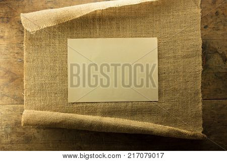 Blank piece of paper space between rolled hemp cloth.