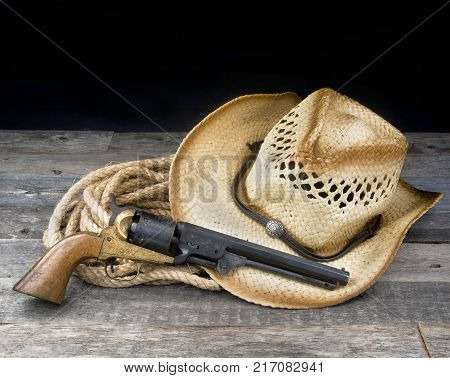 Cowboy pistol straw hat and rope with room for your type.