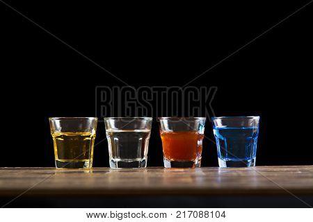 four diferent color mini glass shot alcoholic drink