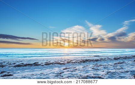 Beautiful seascape sunset over the sea. Indian ocean at Australia near Perth.Golden bay