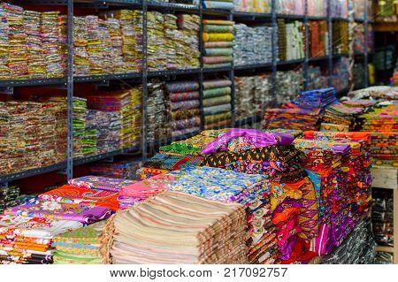 Textiles for sale in fabric shop. Drapery store.