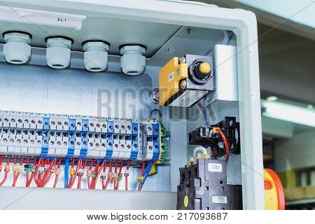 Position switch a master switch and bushing terminals in electrical cabinet. At the Assembly site modern electrical Cabinet. Reliable electrical equipment and components.
