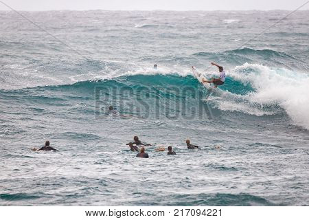 SUNSET BEACH HAWAII USA - DECEMBER 2, 2017: Competitive surfers at the 2017 Vans World Cup of Surfing competition at Sunset Beach on Oahu's scenic North Shore. This is the second of three surfing competitions and Conner Coffin