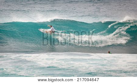 SUNSET BEACH HAWAII USA - DECEMBER 2, 2017: Competitive surfers at the 2017 Vans World Cup of Surfing competition at Sunset Beach on Oahu's scenic North Shore. This is the second of three surfing competitions and Conner Coffin took first place.